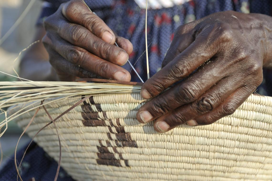 A skilled basket-maker at work in the North